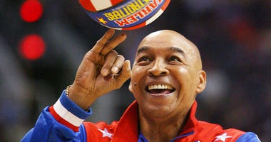 "Harlem Globetrotters' Fred ""Curly"" Neal performs during a timeout in the second quarter in an NBA basketball game"