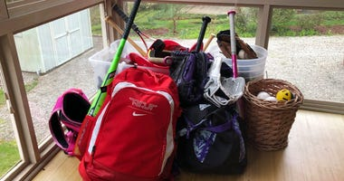 Baseball and softball bags lie untouched. The spring seasons for both children's youth leagues are on hold and in danger of being canceled due to the COVID-19 pandemic.