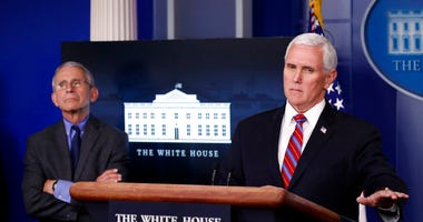 Dr. Anthony Fauci, director of the National Institute of Allergy and Infectious Diseases, listens as Vice President Mike Pence