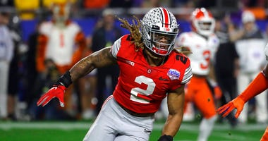 Ohio State defensive end Chase Young (2) moves in on the play during the first half of the Fiesta Bowl NCAA college football game against Clemson, in Glendale, Ariz. Young is a likely first round pick in the NFL Draft Thursday, April 23, 2020.