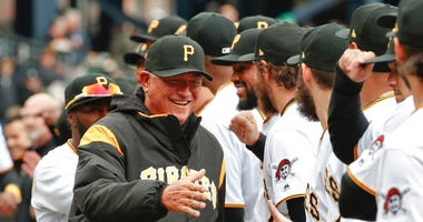 Pittsburgh Pirates' Clint Hurdle, left, greets players as he ins introduced before the Pirates' home opener baseball game against the Minnesota Twins in Pittsburgh.
