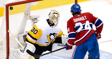 Montreal Canadiens centre Phillip Danault (24) watches as the puck bounces off the post behind Pittsburgh Penguins goaltender Matt Murray (30) during the third period of an NHL hockey playoff game Wednesday, Aug. 5, 2020 in Toronto