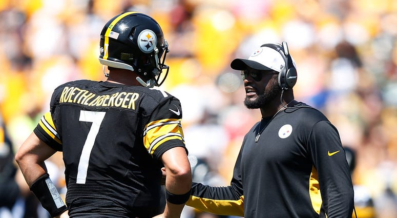 Head coach Mike Tomlin of the Pittsburgh Steelers talks with quarterback Ben Roethlisberger #7