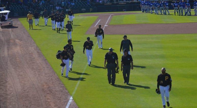 Pirates walk off field