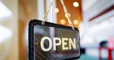Open sign in business window