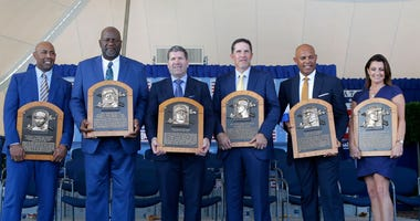 : Inductees (from left) Harold Baines, Lee Smith, Edgar Martinez, Mike Mussina, Mariano Rivera and Brandy Halladay, wife the late Roy Halladay, pose with their plaques