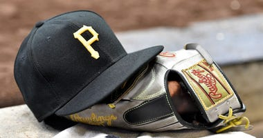 Pittsburgh Pirates baseball cap and a baseball glove