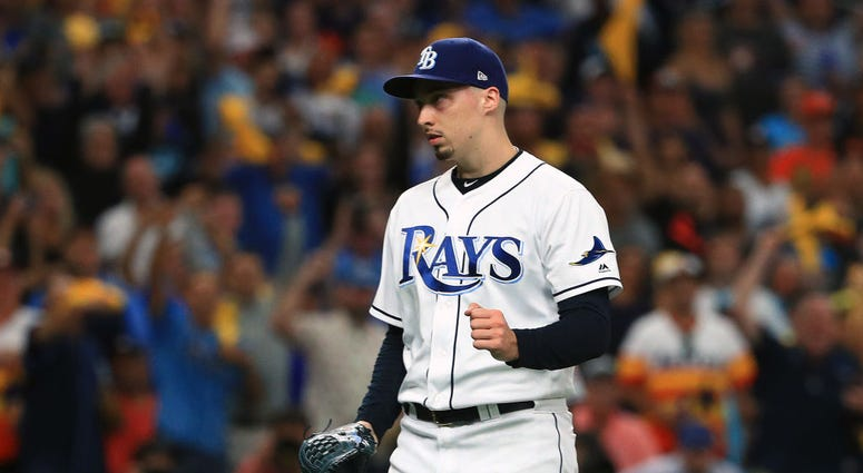 Blake Snell #4 of the Tampa Bay Rays celebrates his team's win.