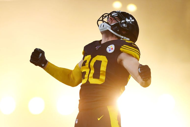 T.J. Watt #90 of the Pittsburgh Steelers jumps in the air as he runs onto the field before a game