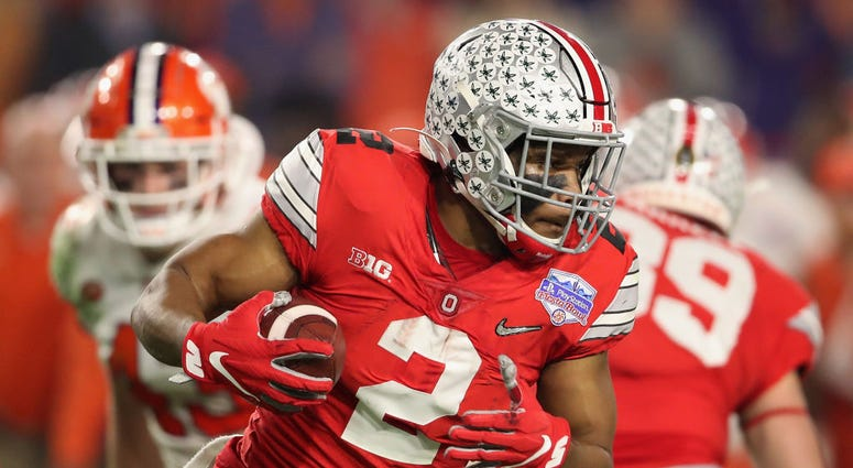 Running back J.K. Dobbins #2 of the Ohio State Buckeyes rushes the football against the Clemson Tigers.