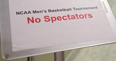 "A sign reads 'No Spectators"" during the NCAA Division III Men's Basketball Championship"