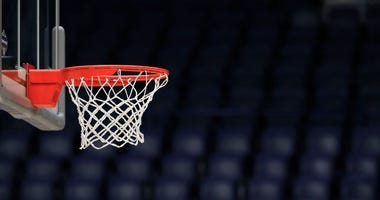 The basket and the arena sit unused after the announcement of the cancellation of the SEC Basketball Tournament