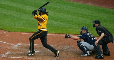 Josh Bell #55 of the Pittsburgh Pirates hits a walk off two RBI double in the tenth inning against the Milwaukee Brewers at PNC Park on July 15, 2018 in Pittsburgh.