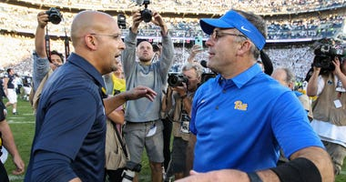 Penn State Nittany Lions head coach James Franklin (left) and Pittsburgh Panthers head coach Pat Narduzzi (right) congratulate each other at mid field following the competition of the game at Beaver Stadium