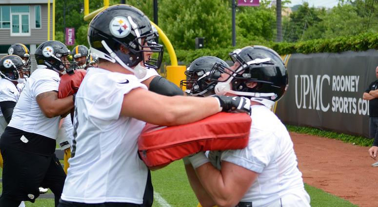 Steelers OT Bryce Harris (left) goes through first OTA