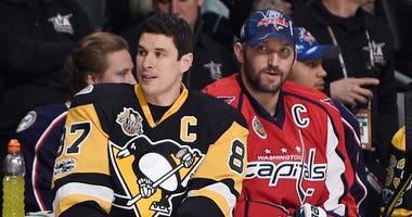 Pittsburgh Penguins forward Sidney Crosby sits next to Washington Capitals forward Alex Ovechkin