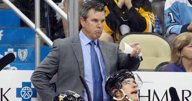 Pittsburgh Penguins head coach Mike Sullivan (top) gestures on the bench against the Montreal Canadiens during the second period at PPG PAINTS Arena. Montreal won 5-1.