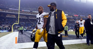 Pittsburgh Steelers outside linebacker James Harrison (92) and head coach Mike Tomlin walk off the field following a 39-30 loss against the Seattle Seahawks at CenturyLink Field.
