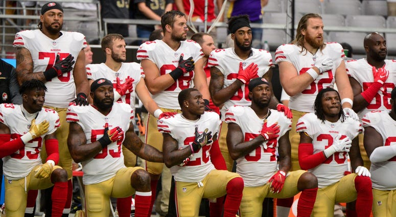 NFL players kneel during National Anthem
