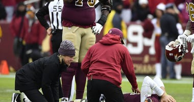 Washington Redskins quarterback Alex Smith (11) reacts after breaking his leg in the second half against the Houston Texans