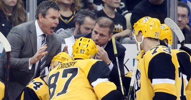 Mike Sullivan talks to his team