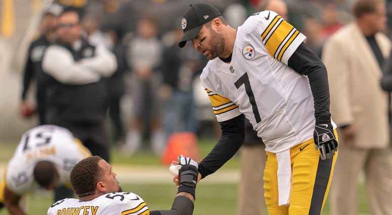 Pittsburgh Steelers quarterback Ben Roethlisberger (7) and center Maurkice Pouncey (53) before the start of the game against the Oakland Raiders at Oakland Coliseum.