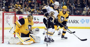 Pittsburgh Penguins goaltender Casey DeSmith (1) makes a save against Boston Bruins center Ryan Donato