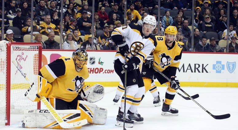 Pittsburgh Penguins goaltender Casey DeSmith (1) makes a save against Boston Bruins center Ryan Donato