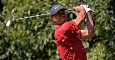 Tiger Woods plays his shot from the second tee during the final round of the WGC - Mexico Championship golf tournament at Club de Golf Chapultepec.