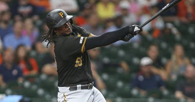 Pittsburgh Pirates designated hitter Josh Bell (55) hits a home run during the first inning against the Houston Astros at Minute Maid Park.