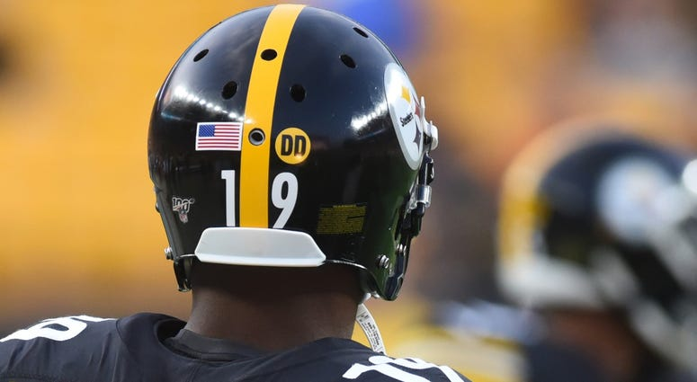 The Pittsburgh Steelers wear a DD decal on their helmets in honor of late coach Darryl Drake at Heinz Field