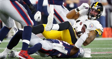 New England Patriots free safety Devin McCourty (32) tackles Pittsburgh Steelers running back James Conner (30) during the first half at Gillette Stadium.