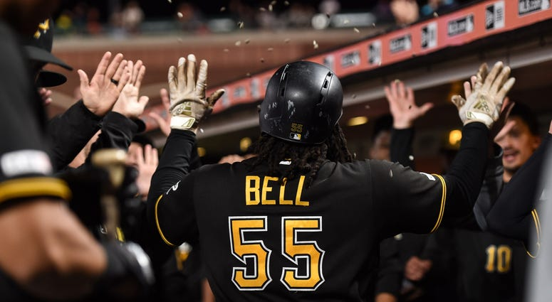 ittsburgh Pirates first baseman Josh Bell (55) celebrates with teammates in the dugout after hitting a two-run home run