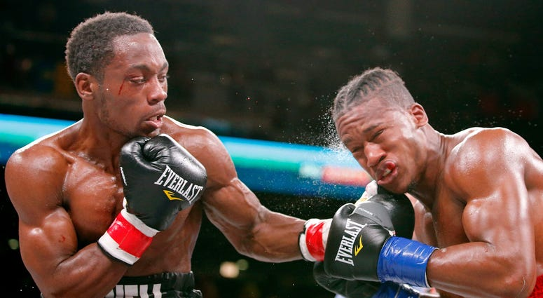 Charles Conwell (black trunks) and Patrick Day (red trunks) box during a USBA Super-Welterweight boxing match at Wintrust Arena.