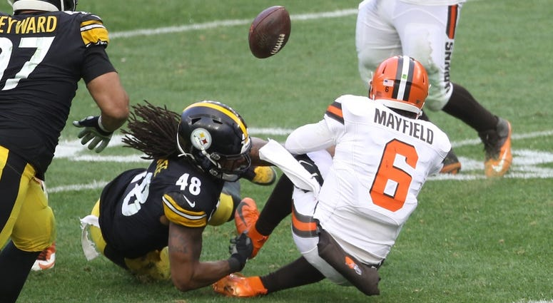 Pittsburgh Steelers outside linebacker Bud Dupree (48) forces Cleveland Browns quarterback Baker Mayfield to fumble during the third quarter at Heinz Field.