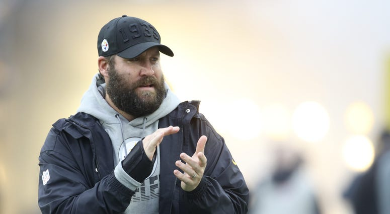 Pittsburgh Steelers quarterback Ben Roethlisberger (7) gestures during player introductions against the Cleveland Browns during the first quarter at Heinz Field.
