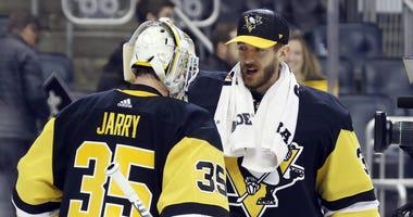 Pittsburgh, PA, USA; Pittsburgh Penguins goaltender Tristan Jarry (35) is congratulated by fellow goaltender Matt Murray