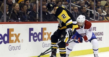 Pittsburgh Penguins defenseman Chad Ruhwedel (2) plays the puck in his skates against Montreal Canadiens right wing Riley Barber (45)