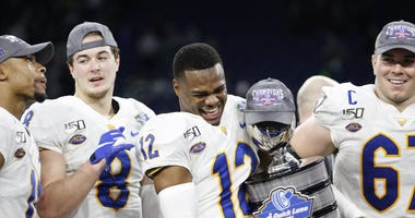 Paris Ford celebrates after the Quick Lanes Bowl victory