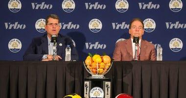 Michigan head coach Jim Harbaugh and Alabama head coach Nick Saban