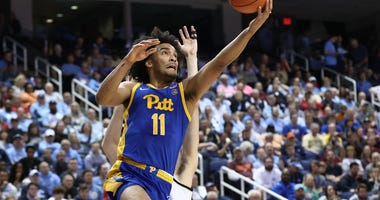 Mar 10, 2020; Greensboro, North Carolina, USA; Pittsburgh Panthers guard Justin Champagnie (11) goes up for a shot against the Wake Forest Demon Deacons at Greensboro Coliseum.