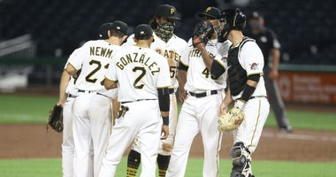 Pirates meet at the mound