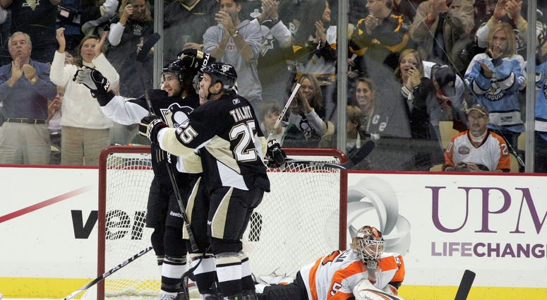 Pittsburgh Penguins Kris Letang (58) and Max Talbot (25) celebrate scoring in front of Philadelphia Flyers goalie Sergei Bobrovsky (35) during the first period at the CONSOL Energy Center.