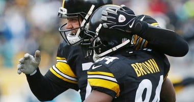 Pittsburgh Steelers quarterback Ben Roethlisberger (7) celebrates with Steelers wide receiver Antonio Brown (84) after a touchdown against the Miami Dolphins in the AFC Wild Card playoff football game at Heinz Field.