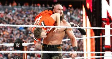 WWE star Braun Strowman lifts Colin Jost at Wrestlemania 35 in 2019 at MetLife Stadium.