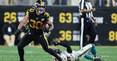 Pittsburgh Steelers running back James Conner (30) carries the ball past Miami Dolphins cornerback Jomal Wiltz (33) during the second quarter at Heinz Field.