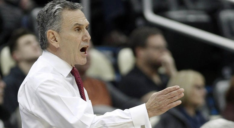 Duquesne Dukes head coach Keith Dambrot gestures on the sidelines against the Pittsburgh Panthers during the first half at PPG Paints Arena. Pittsburgh won 74-53.