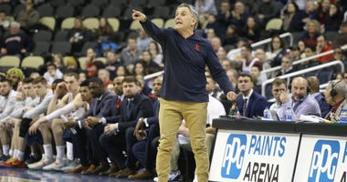Duquesne Dukes head coach Keith Dambrot reacts on the sidelines against the Dayton Flyers during the second half at PPG Paints Arena. Dayton won 73-69.