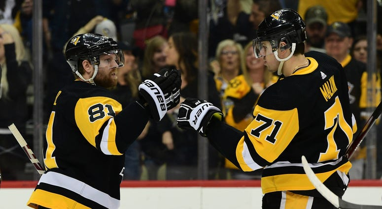 Pittsburgh Penguins forward Phil Kessel (81), left, celebrates with forward Evgeni Malkin (71) after scoring a goal during the second period against the Detroit Red Wings at PPG PAINTS Arena.