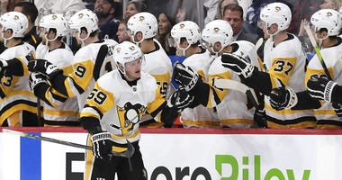 Pittsburgh Penguins center Jake Guentzel (59) celebrates after scoring a goal in the second period against the Winnipeg Jets at Bell MTS Place.